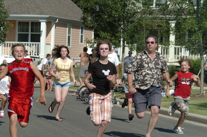 People running through neighborhood